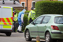 © Licensed to London News Pictures. 25/05/2015. DIDCOT, UK. Police and forensic officers at the scene in Vicarage Road, Didcot, where three bodies were found yesterday (Sunday). Police continue to search for Jed Allen in connection with the deaths. Photo credit : Cliff Hide/LNP