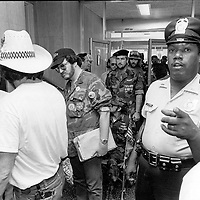 A security guard in the VA Buidling in Washington, DC attempt to prevent a photographer from taking pictures prior to a meeting between protesting Agent Orange veterans and VA officials in Washington, DC on May 13, 1982.