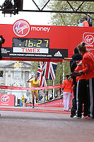 Katy-Ann McDonald of Wandsworth crosses the line to win the Borough Challenge of the Girls U15 race in the Virgin Giving Mini London Marathon, Sunday 26th April 2015.<br /> <br /> Scott Heavey for Virgin Money London Marathon<br /> <br /> For more information please contact Penny Dain at pennyd@london-marathon.co.uk