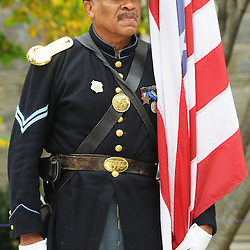 Photos by Tom Kelly IV<br /> Cpl. Robert Fuller Houston of the 3rd Regiment Infantry of the United State Colored Troops, a group of Civl War reenactors holds the American Flag during the dedication of the Frederick Douglass statue at West Chester University, Tuesday afternoon October 1, 2013.