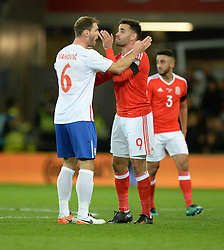 Hal Robson-Kanu of Wales and Branislav Ivanovic of Serbia confront each other. - Mandatory by-line: Alex James/JMP - 12/11/2016 - FOOTBALL - Cardiff City Stadium - Cardiff, United Kingdom - Wales v Serbia - FIFA European World Cup Qualifiers
