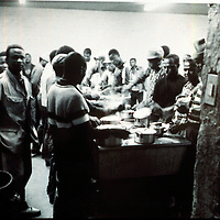 Migrant workers prpare supper in Mamelodi hostel, Mamelodi, Pretortia, 1989. Scanned from original polaroid.