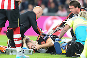 Luke Shaw of Manchester United is helped by the paramedics during the Champions League Group B match between PSV Eindhoven and Manchester United at Philips Stadion, Eindhoven, Netherlands on 15 September 2015. Photo by Phil Duncan.