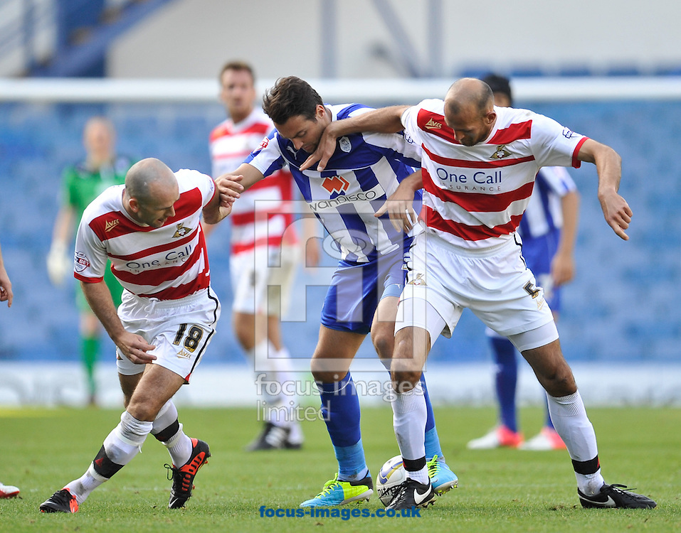 Picture by Richard Land/Focus Images Ltd +44 7713 507003<br /> 28/09/2013<br /> Atdhe Nuhiu of Sheffield Wednesday is closed out by Paul Keegan (L) &amp; Rob Jones (R) of Doncaster Rovers during the Sky Bet Championship match at Hillsborough, Sheffield.