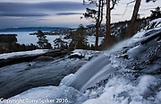 """""""Winter at Emerald Bay"""" - A long exposure photograph of a partially frozen eagle falls with Emerald Bay in the background"""