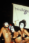 Topless dancers dressed up for the Privilege club parade, Ibiza 1998