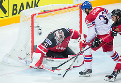 Petr Caslava of Czech Republic vs Mike Smith of Canada and Aaron Ekblad of Canada during Ice Hockey match between Canada and Czech Republic at Semifinals of 2015 IIHF World Championship, on May 16, 2015 in O2 Arena, Prague, Czech Republic. Photo by Vid Ponikvar / Sportida