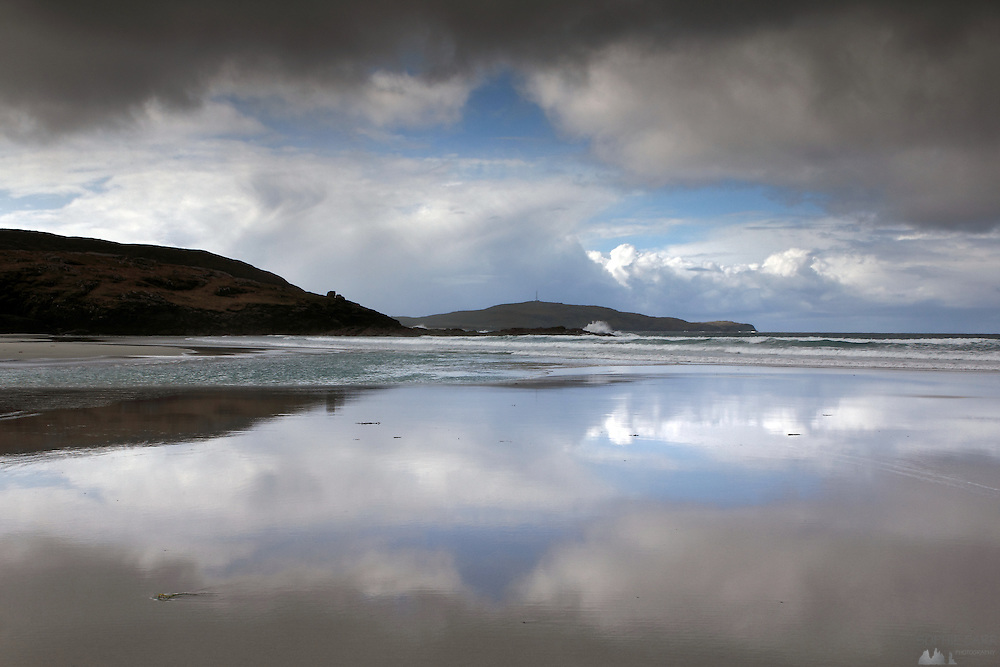 Reflections on the western beach at Eoligarry, at the northern end of Barra, Outer Hebrides, Scotland