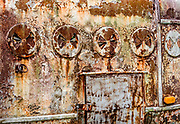 An antique horse trailer found along Oak Grove Road (740), Virginia, features a variety of oxidized metal and peeling paint textures which contribute to interesting abstract compositions.