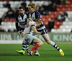 Bristol Rugby centre, Jack Tovey is tackled by London Scottish new fly half Connor Braid - Photo mandatory by-line: Paul Knight/JMP - Mobile: 07966 386802 - 05/12/2014 - SPORT - Rugby - Bristol - Ashton Gate - Bristol Rugby v London Scottish - B&I Cup