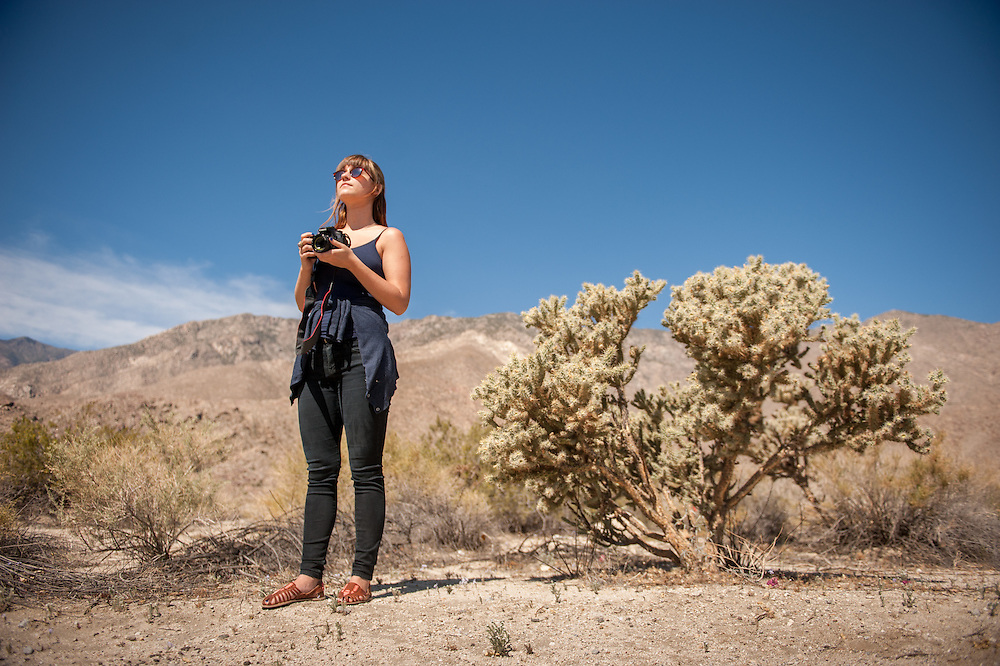 Young woman holding camera near Palm Springs, California