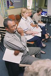 NHS staff attending antismoking training session,