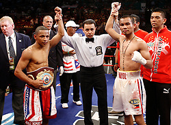 June 13, 2009; New York, NY, USA;  WBO Jr. Flyweight Champion Ivan Calderon and challenger Rodel Mayol draw during their bout at Madison Square Garden. The fight ended in a draw after a clash of heads caused the fight to be stopped in the fifth round.  Mandatory Credit: Ed Mulholland