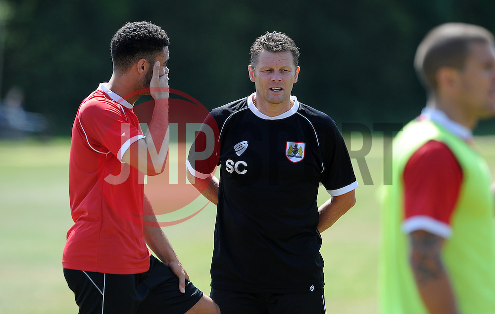 Bristol City manager, Steve Cotterill with Bristol City's Derrick Williams- Photo mandatory by-line: Dan Rowley/JMP - Tel: Mobile: 07966 386802 02/07/2014 - SPORT - FOOTBALL - Bristol -  Bristol City Training