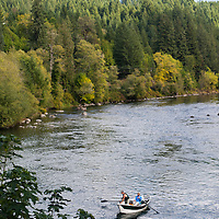 Fly fishermen on a boat in the McKenzie River near the Goodpasture Bridge in Vida, Oregon.