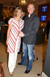 Presenter CAROLINE FERADAY and NEIL SMITH at a fundraising evening for the Conservative Party General Election Campaign Fund held at Bonhams, 101 New Bond Street, London W1 on 17th March 2005.<br /><br />NON EXCLUSIVE - WORLD RIGHTS