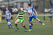 Brighton's Kate Natkiel and Forest Green's Francis Davis battle for the ball during the FA Women's Premier League match between Forest Green Rovers Ladies and Brighton Ladies at the Hartpury College, United Kingdom on 24 January 2016. Photo by Shane Healey.