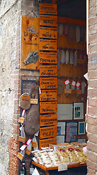 Regional food specialties for sale along the primary shopping street, Via S. Giovanni.