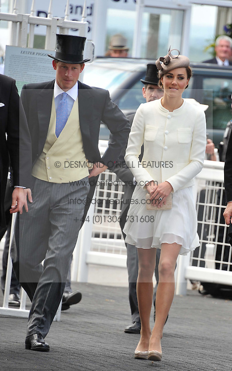 PRINCE HARRY and HRH The DUCHESS OF CAMBRIDGE at the Investec Derby at Epsom Racecourse, Epsom Downs, Surrey on 4th June 2011.