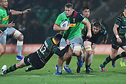 Harlequins back row Alex Dombrandt (8) is tackled by Northampton Saints centre Andy Symons (12) during the Gallagher Premiership Rugby match between Northampton Saints and Harlequins at Franklins Gardens, Northampton, United Kingdom on 1 November 2019.