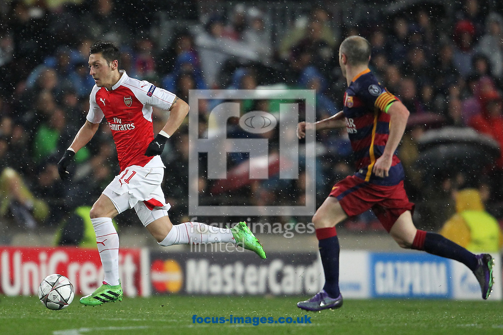 Mesut Ozil of Arsenal runs with the ball during the UEFA Champions League match at Camp Nou, Barcelona<br /> Picture by Yannis Halas/Focus Images Ltd +353 (87) 258201<br /> 16/03/2016