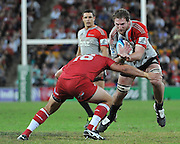 Kieran Read barges into the tackle of James Hanson ~ Super 15 rugby (Round 15) - Reds v Crusaders played at Suncorp Stadium, Brisbane, Australia on Sunday 29th May 2011 ~ Photo : Steven Hight (AURA Images) / Photosport