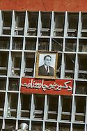 Afghanistan. the communist regime  / after the coup d 'etat of Afizoulah Amin against Taraki changing the photo of taraki by the new leader  kabul  Afghanistan  / Le regime communiste. Apres le coup d etat de Afizoulah Amin contre Taraki. on remplace la photo du l'ancien dirigeant Taraki   Kaboul  Afghanistan  / nb 26700 25 / 26700 / L0055661