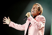Sir Cliff Richard and The Shadows performs live on stage at the O2 Arena on September 28, 2009 in London, England.  (Photo by Simone Joyner)