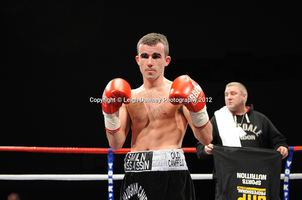 Paul Edwards (black shorts) defeats Stefan Slavchev in a Flyweight contest on 3rd March 2012 at the Hillsborough Leisure Centre. Frank Maloney & Dennis Hobson Promotions © Leigh Dawney Photography 2012.Paul Edwards (black shorts) defeats Stefan Slavchev in a Flyweight contest on 3rd March 2012 at the Hillsborough Leisure Centre. Frank Maloney & Dennis Hobson Promotions © Leigh Dawney Photography 2012.