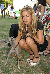 JADE JAGGER and her dog Ella at the Macmillan Cancer Support Dog Day held in the gardens of the Royal Hospital, Chelsea, London on 4th July 2006.<br /><br />NON EXCLUSIVE - WORLD RIGHTS