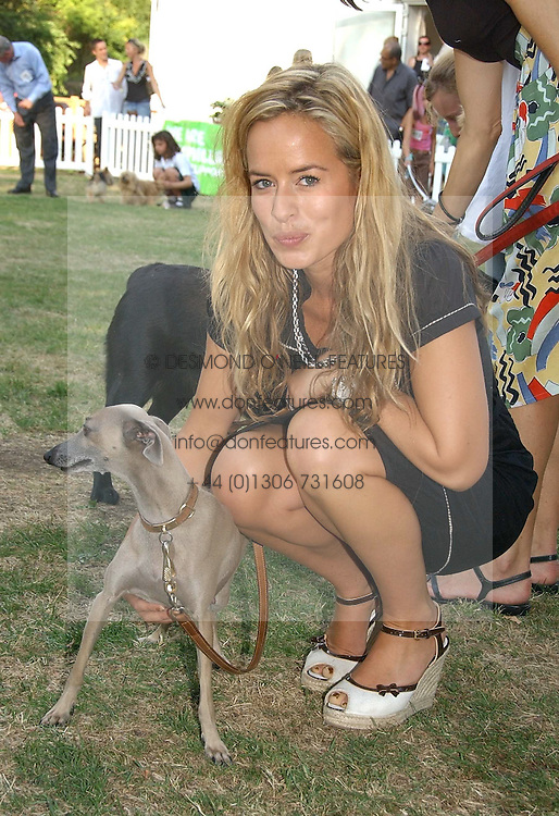 JADE JAGGER and her dog Ella at the Macmillan Cancer Support Dog Day held in the gardens of the Royal Hospital, Chelsea, London on 4th July 2006.<br />
