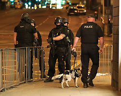 Armed police after a suspected terrorist attack at the Manchester Arena at the end of a concert by US star Ariana Grande left 19 dead.