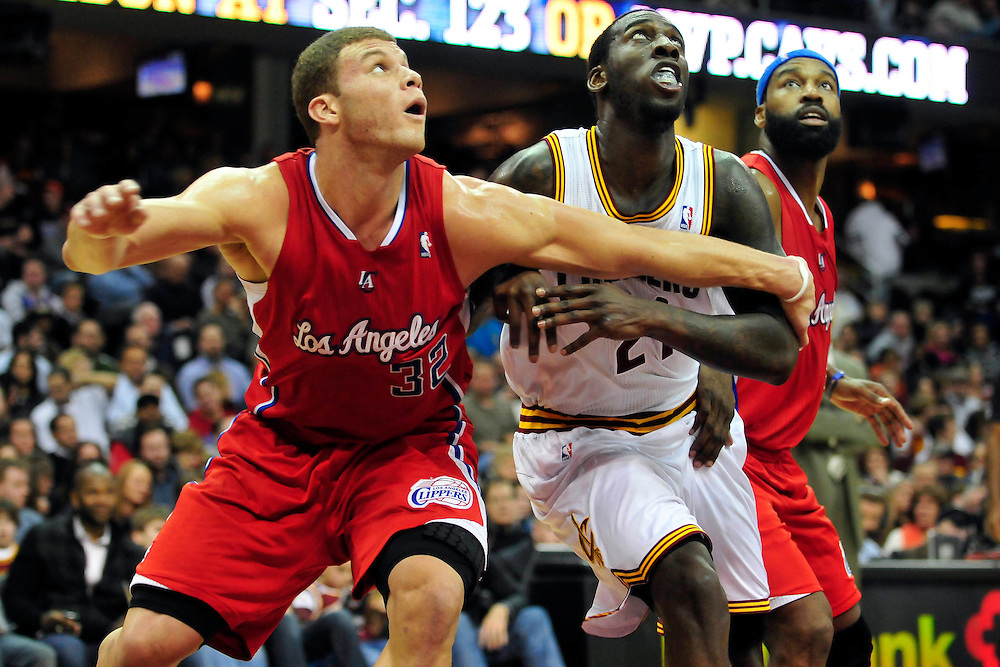 Feb. 11, 2011; Cleveland, OH, USA; Los Angeles Clippers power forward Blake Griffin (32) and point guard Baron Davis (5) fight Cleveland Cavaliers power forward J.J. Hickson (21) for a rebound during the second quarter at Quicken Loans Arena. Mandatory Credit: Jason Miller-US PRESSWIRE