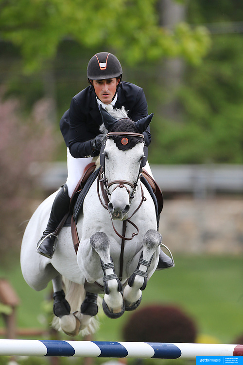 Nicholas Dello Joio riding Contiki in action during the $35,000 Grand Prix of North Salem presented by Karina Brez Jewelry during the Old Salem Farm Spring Horse Show, North Salem, New York, USA. 15th May 2015. Photo Tim Clayton