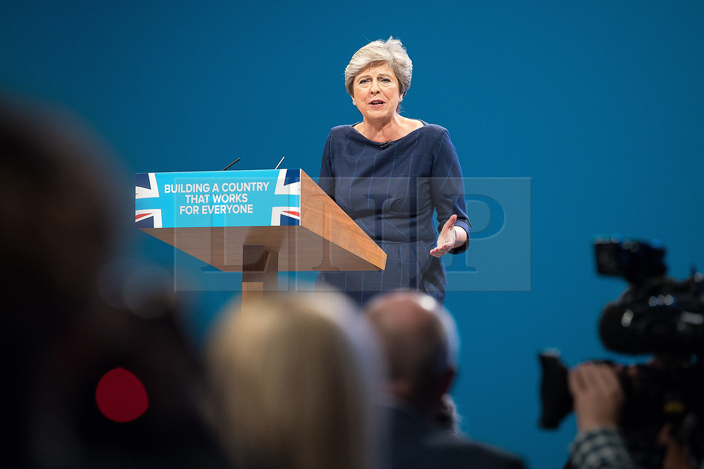 © Licensed to London News Pictures . 04/10/2017. Manchester, UK. Prime Minister THERESA MAY delivers her keynote speech on the fourth and final day of the Conservative Party Conference at the Manchester Central Convention Centre . Photo credit: Joel Goodman/LNP
