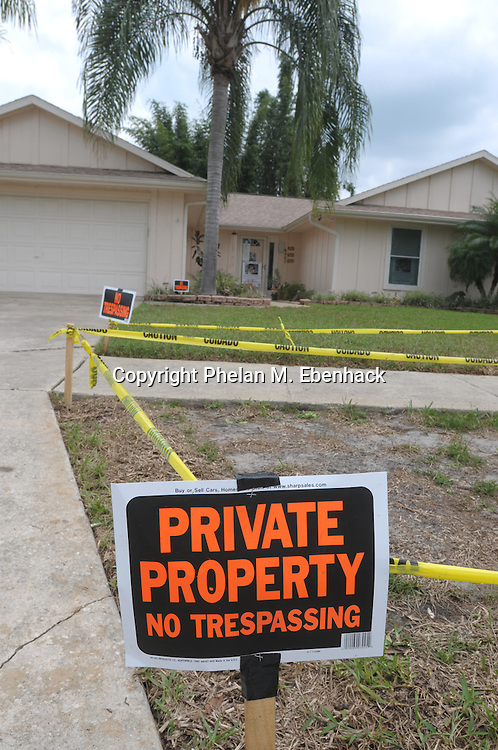 No Tresspassing signs and caution tape are posted outside the Anthony family home after Casey Anthony was released from jail for the third time in Orlando, Florida, Tuesday, Sept. 16, 2008.  Casey Anthony, mother of missing three-year-old Caylee Anthony is out on bond for economic and child-endangerment charges relating to her missing daughter.