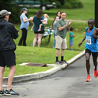 Tupelo residents stand and cheer as the lead runner passes them on Clayton Ave during the Gumtree Run Saturday morning in Tupelo.