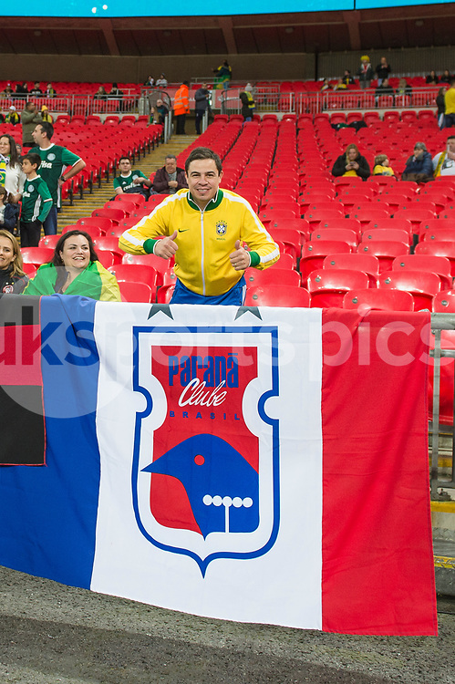 A Brazilian fan poses with his club side flag ahead of the international friendly match between England and Brazil at Wembley Stadium, London, England on 14 November 2017. Photo by Darren Musgrove.
