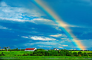 Rainbow and barn after storm<br /> St. Gedeon<br /> Quebec<br /> Canada