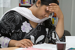 Woman learning at adult education centre,