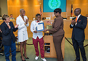 Marmion Dambrino and Trustee Jolanda Jones, Trustee Wanda Adams and Houston ISD Interim Superintendent Ken Huewitt congratulate Brandolyn Walker during a meeting of the Board of Trustees, June 9, 2016.