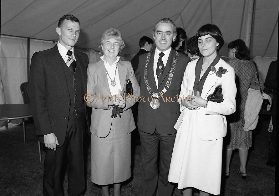Guests and staff at the US Embassy in Phoenix Park, Dublin, celebrate American Independence Day..1980-07-04.4th July 1980.04/07/1980.07-04-80..Photographed at the US Ambassador's Residence,  Phoenix Park...Guests and staff at the US Embassy in Phoenix Park, Dublin, celebrate American Independence Day..1980-07-04.4th July 1980.04/07/1980.07-04-80..Photographed at the US Ambassador's Residence,  Phoenix Park...Fergus O'Brien, the mayor of Dublin and his wife (centre) pose for the camera with other guests in the marquee during festivities...