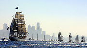 The Tall Ship Europa, left, the largest of the Tall Ships in the parade, follows other ships in a sailpast in Elliott Bay, August 15, 2002. (Greg Gilbert/The Seattle Times)