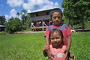 House in community a little down river from Tena, Ecuador, brother and sister