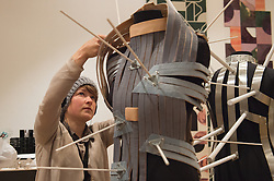 © London News Pictures. 23/06/15. London, UK. Sabine Roth makes the final adjustment to her design 'Sensable Space' which she co-developed with Cameron Bowen, Royal College of Art Graduate Exhibition 2015, Central London. Photo credit: Laura Lean/LNP
