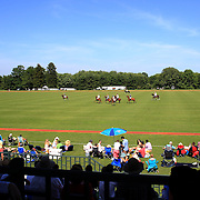 Spectators watching polo from the stands during the Airstream vs. Cinque Terre Polo match at the Greenwich Polo Club, Greenwich, Connecticut, USA. 23rd June 2013. Photo Tim Clayton