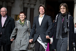 February 5, 2018 - London, London, UK - Alleged computer hacker Lauri Love (centre right) leaves the High Court with his partner Sylvia Mann (right) and mother and father (left) after successfully challenged a ruling that he can be extradited to the US. (Credit Image: © Tom Nicholson/London News Pictures via ZUMA Wire)