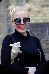 © Licensed to London News Pictures<br /> Fan Nikki Carter, 19, waits outside the Roundhouse in Camden, London, to queue for Lady Gaga's performance tonight.