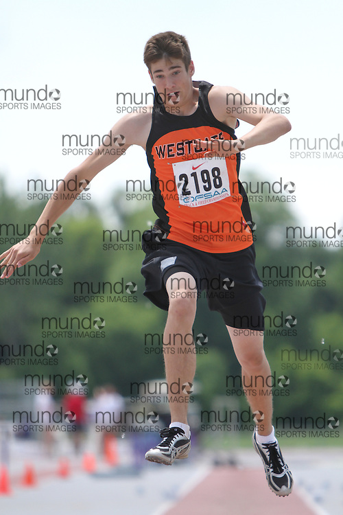 (London, Ontario}---05 June 2010) Justin McGinnis of Westgate - Thunder  Bay competing in the midget boys triple jump at the 2010 OFSAA Ontario High School Track and Field Championships in London, Ontario, June 05, 2010 . Photograph copyright Laura Barclay / Mundo Sport Images, 2010.