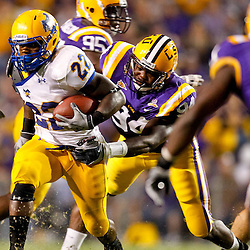 October 16, 2010; Baton Rouge, LA, USA; McNeese State Cowboys running back Andre Anderson (22) is tackled by LSU Tigers defensive end Kendrick Adams (94) during the first half at Tiger Stadium.  Mandatory Credit: Derick E. Hingle